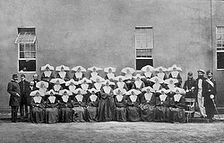 Nurses with the Daughters of Charity pose in undated photo with Civil War soldiers outside Philadelphia hospital